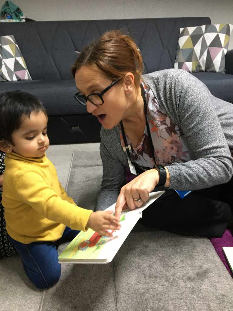 Child sharing book